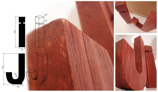 Imágenes diseño tipografía helvetica bold en madera